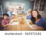 family having breakfast in... | Shutterstock . vector #565572181