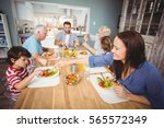 happy family having breakfast... | Shutterstock . vector #565572349