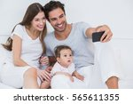 happy family clicking selfie on ... | Shutterstock . vector #565611355