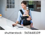 woman carrying baby girl while... | Shutterstock . vector #565668109
