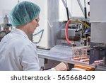 pharmaceutical production line... | Shutterstock . vector #565668409