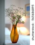Small photo of Amber glass fluted vase with flowers in a room