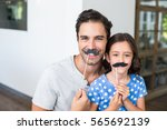Portrait Of Smiling Father And...