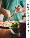woman preparing pizza in the... | Shutterstock . vector #565706191