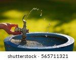 water running in drinking... | Shutterstock . vector #565711321