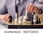 young businessman playing chess ... | Shutterstock . vector #565722031