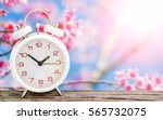 white clock on wooden with pink ... | Shutterstock . vector #565732075