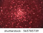 shiny red hearts background.... | Shutterstock . vector #565785739