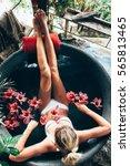 woman relaxing in round outdoor ...   Shutterstock . vector #565813465