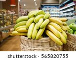 basket with fresh ripe bananas... | Shutterstock . vector #565820755