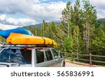 boats on top of a car. | Shutterstock . vector #565836991