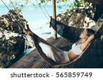 woman relaxing in the hammock... | Shutterstock . vector #565859749
