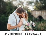 the bride and groom in nature.... | Shutterstock . vector #565881175