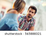 young couple sitting in a cafe  ... | Shutterstock . vector #565888321
