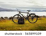 bicycle and travel bag near the ... | Shutterstock . vector #565899109
