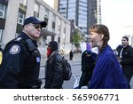 Small photo of TORONTO -NOVEMBER 5:A protester having an altercation with the police in front of the US Consulate during a rally to protest Dakota Access Pipeline construction on November 5, 2016 in Toronto,Canada.