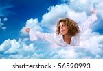 Flying girl in the blue sky. Surreal - stock photo