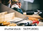 carpenter holding a hand saw on ... | Shutterstock . vector #565918081