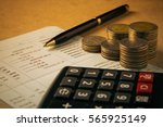 row of coins calculator on the... | Shutterstock . vector #565925149
