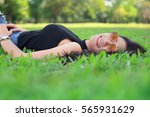 young woman relaxing with good... | Shutterstock . vector #565931629