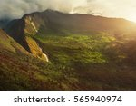 high mountains covered by trees....   Shutterstock . vector #565940974