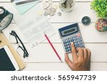accountant verify the saving... | Shutterstock . vector #565947739