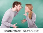 Small photo of Bad relationship and divorce. Expressive young couple yelling shouting. Husband and wife having big emotional argue split quarrel.