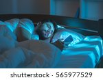 the serious man lay on the bed... | Shutterstock . vector #565977529