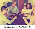 portrait of smiling parents and ... | Shutterstock . vector #566006971