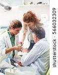 dentist and her female... | Shutterstock . vector #566032309