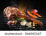 tomahawk rib beef steak on hot... | Shutterstock . vector #566042167