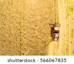 Small photo of Aerial view of combine harvester. Harvest of rapeseed field. Industrial background on agricultural theme. Biofuel production from above. Agriculture and environment in European Union.