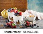 yogurt parfait with granola and ... | Shutterstock . vector #566068801