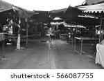 black homeless dog in the market | Shutterstock . vector #566087755