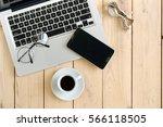 wooden desk with various... | Shutterstock . vector #566118505