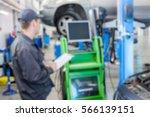 man working in the auto repair... | Shutterstock . vector #566139151