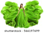 fashion model waving dress as...   Shutterstock . vector #566197699