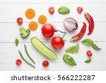 fresh vegetables on wooden... | Shutterstock . vector #566222287