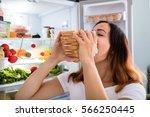 woman eating sandwich | Shutterstock . vector #566250445