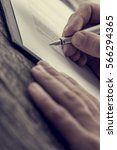 close up view of man hands with ... | Shutterstock . vector #566294365