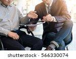 teamwork process. young... | Shutterstock . vector #566330074