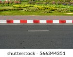 Small photo of Asphalt road with red and white traffic sign at sidewalk curb
