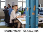 side view of young woman work... | Shutterstock . vector #566369605