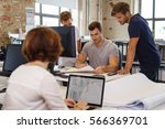 young colleagues working... | Shutterstock . vector #566369701