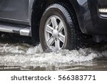 pickup truck on a flooded street | Shutterstock . vector #566383771