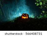 an eerily glowing jack o... | Shutterstock . vector #566408731