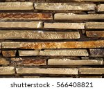 wall built of flat stones | Shutterstock . vector #566408821