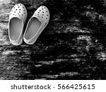 Old Rubber Slippers On Wooden...