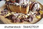 chocolate toast on wood... | Shutterstock . vector #566427019