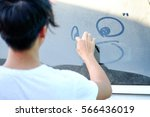 young man drawing a smiley face ... | Shutterstock . vector #566436019